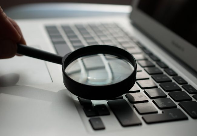 Magnifying glass used on a laptop.