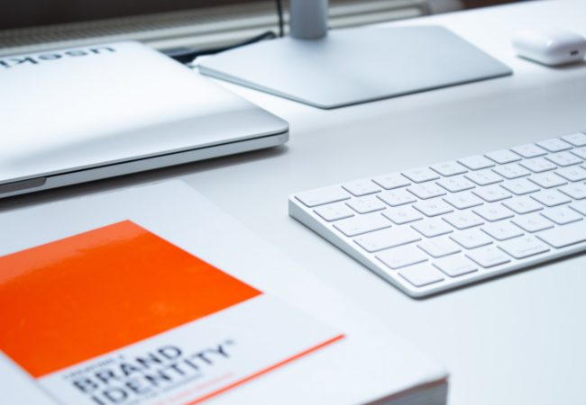 A book about brand identity on a desk.